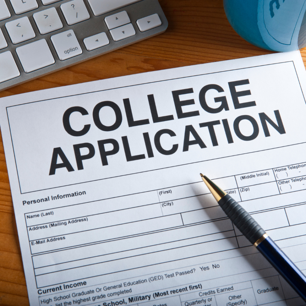 An incompleet college application and open on a wooden desk